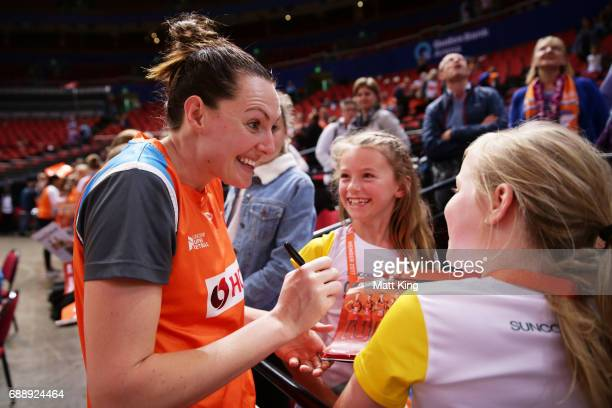 Sam Poolman of the Giants signs autographs and interacts with young fans after the round 14 Super Netball match between the Giants and the Lightning...