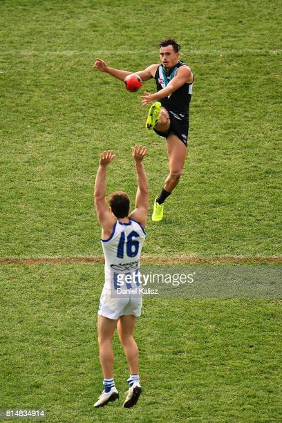 Sam PowellPepper of the Power kicks the ball during the round 17 AFL match between the Port Adelaide Power and the North Melbourne Kangaroos at...