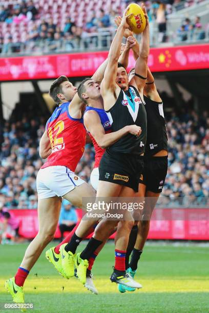 Sam PowellPepper of the Power marks the ball against Tom Rockliff of the Lions during the round 13 AFL match between the Port Adelaide Power and the...