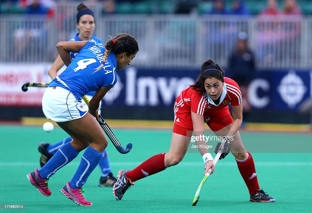 Sam Quek of England battles with Dalila Mirabella of Italy during the Investec Hockey World League quarterfinal match between England and Italy at the Quintin Hogg Memorial Sports Grounds on June 27, 2013 in London, England.