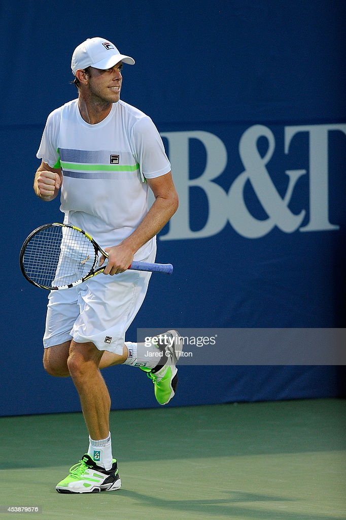 Sam Querrey celebrates after defeating Kevin Anderson of South Africa during the Winston-Salem Open at Wake Forest University on August 20, 2014 in Winston Salem, North Carolina.