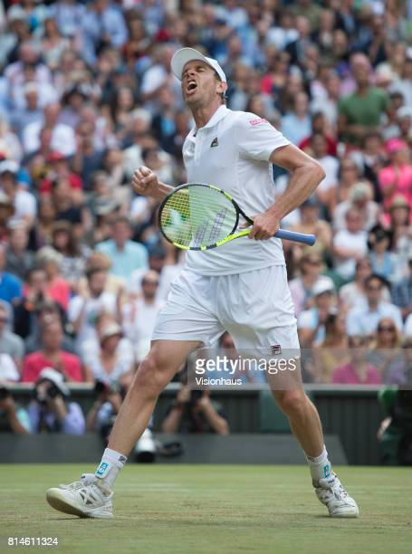 Sam Querrey celebrates victory in his quarterfinal match against Andy Murray during day nine of the Wimbledon Lawn Tennis Championships at the All...