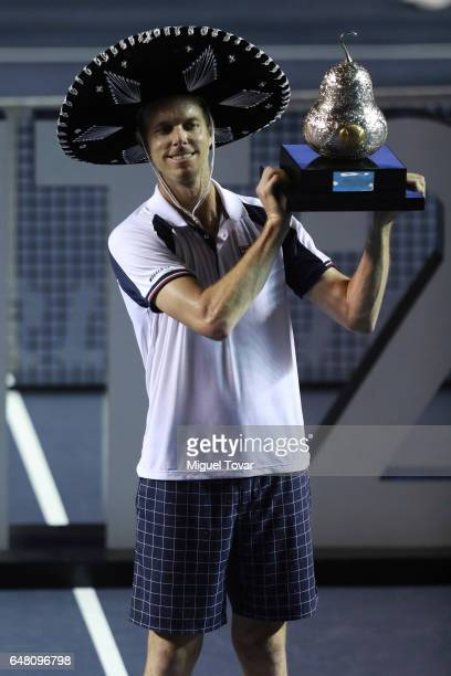 Sam Querrey holds up the trophy after winning the Final match between Sam Querrey and Rafael Nadal as part of the Abierto Mexicano Telcel 2017 at the...