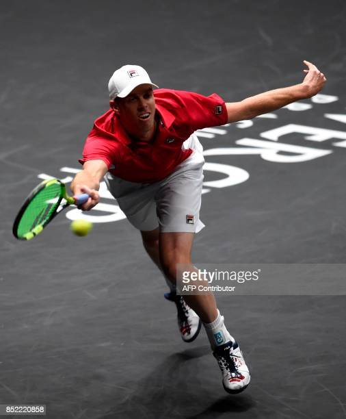 US Sam Querrey of Team World returns the ball to Swiss Roger Federer of Team Europe during second day of Laver Cup on September 23 2017 in O2 Arena...