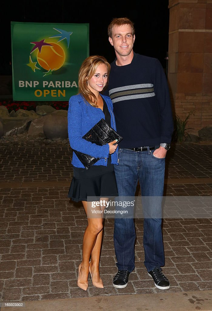 Sam Querrey of the United States and girlfriend Emily McPherson arrive for a player's party at the IW Club on March 7, 2013 in Indian Wells, California.