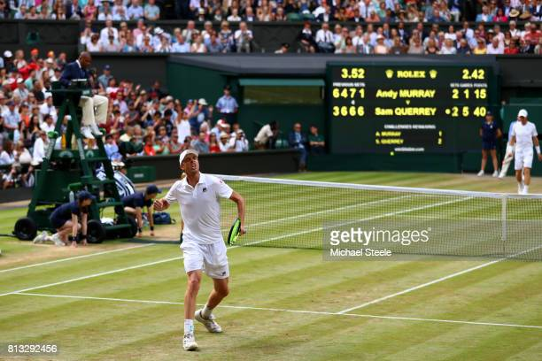 Sam Querrey of The United States celebrates match point and victory during the Gentlemen's Singles quarter final match against Andy Murray of Great...