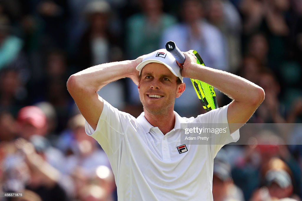 Sam Querrey of The United States celebrates victory during the Men's Singles third round match against Novak Djokovic of Serbia on day six of the Wimbledon Lawn Tennis Championships at the All England Lawn Tennis and Croquet Club on July 2, 2016 in London, England.
