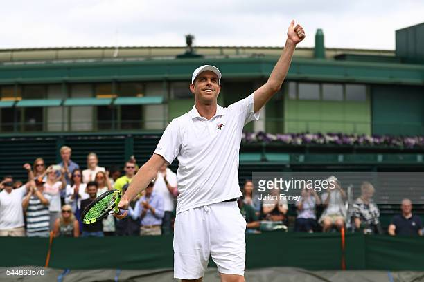 Sam Querrey of The United States celebrates victory during the Men's Singles fourth round match against Nicolas Mahut of France on day seven of the...
