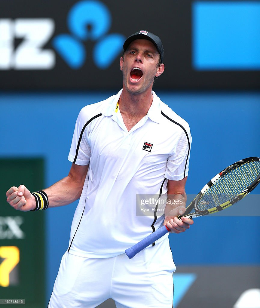 <a gi-track='captionPersonalityLinkClicked' href=/galleries/search?phrase=Sam+Querrey&family=editorial&specificpeople=736491 ng-click='$event.stopPropagation()'>Sam Querrey</a> of the United States celebrates winning in his second round match against Ernests Gulbis of Latvia during day three of the 2014 Australian Open at Melbourne Park on January 15, 2014 in Melbourne, Australia.