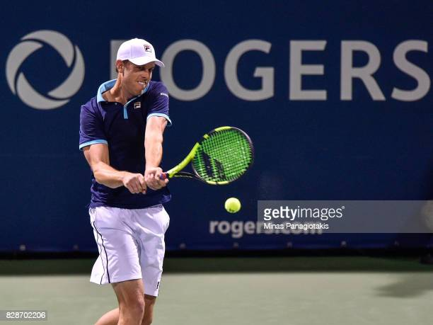 Sam Querrey of the United States hits a return against JoWilfried Tsonga of France during day six of the Rogers Cup presented by National Bank at...