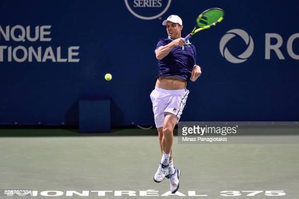 Sam Querrey of the United States hits a return shot against JoWilfried Tsonga of France during day six of the Rogers Cup presented by National Bank...