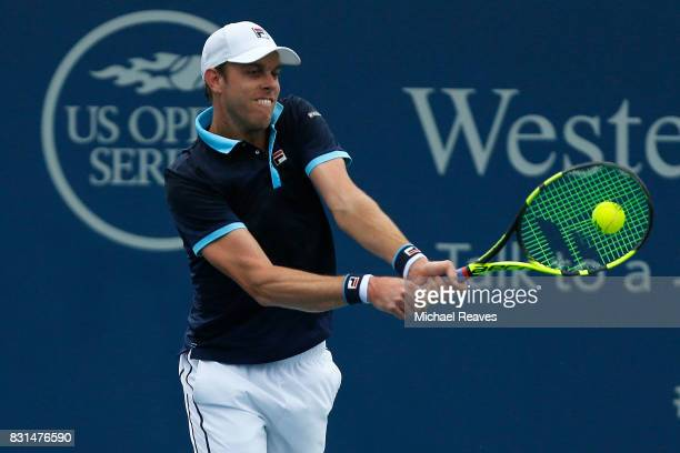 Sam Querrey of the United States of America returns a shot against Stefan Kozlov of the United States of America during Day 3 of the Western and...