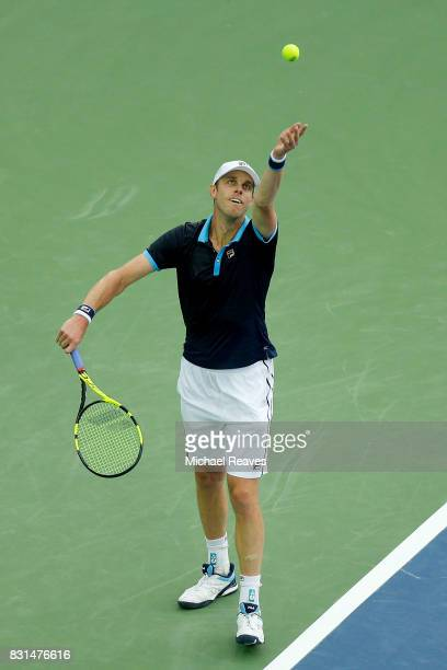 Sam Querrey of the United States of America serves the ball against Stefan Kozlov of the United States of America during Day 3 of the Western and...