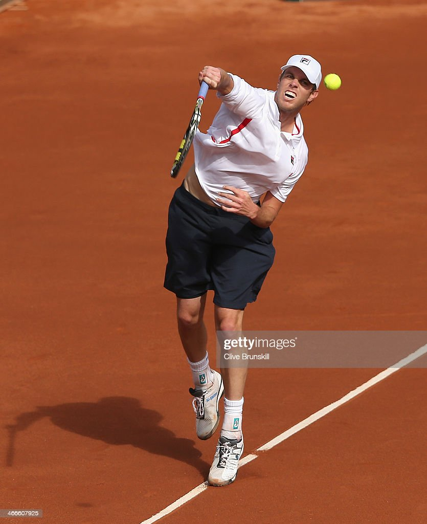 <a gi-track='captionPersonalityLinkClicked' href=/galleries/search?phrase=Sam+Querrey&family=editorial&specificpeople=736491 ng-click='$event.stopPropagation()'>Sam Querrey</a> of the United States plays a smash against Andy Murray of Great Britain during day three of the Davis Cup World Group first round between the U.S. and Great Britain at PETCO Park on February 2, 2014 in San Diego, California.