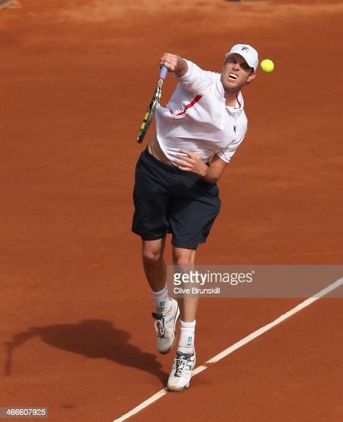 Sam Querrey of the United States plays a smash against Andy Murray of Great Britain during day three of the Davis Cup World Group first round between...