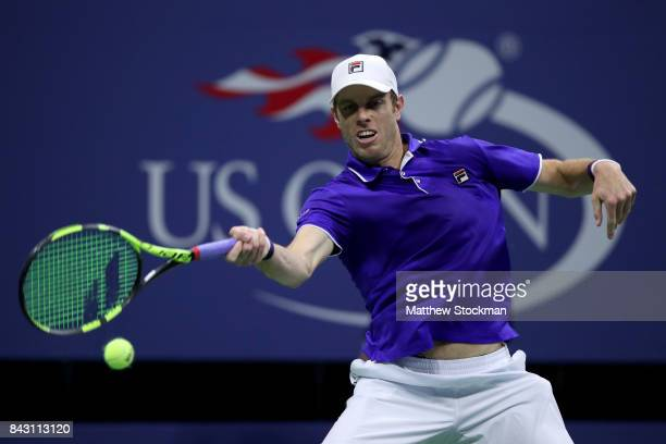 Sam Querrey of the United States returns a shot against Kevin Anderson of South Africa during their Men's Singles Quarterfinal match on Day Nine of...