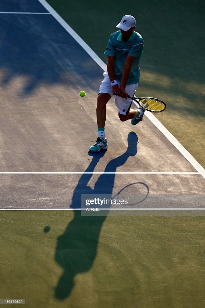 <a gi-track='captionPersonalityLinkClicked' href=/galleries/search?phrase=Sam+Querrey&family=editorial&specificpeople=736491 ng-click='$event.stopPropagation()'>Sam Querrey</a> of the United States returns a shot against Nicolas Mahut of France during their Men's Singles First Round match on Day Two of the 2015 US Open at the USTA Billie Jean King National Tennis Center on September 1, 2015 in the Flushing neighborhood of the Queens borough of New York City.