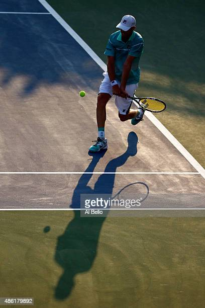 Sam Querrey of the United States returns a shot against Nicolas Mahut of France during their Men's Singles First Round match on Day Two of the 2015...