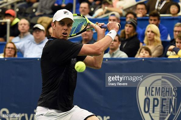 Sam Querrey of the United States returns a shot to Kei Nishikori of Japan during their semifinal singles match on Day 6 of the Memphis Open at the...