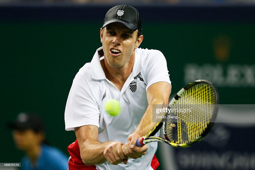 Sam Querrey of the United States returns a shot to Tommy Haas of Germany during day one of the Shanghai Rolex Masters at the Qi Zhong Tennis Center on October 7, 2013 in Shanghai, China.