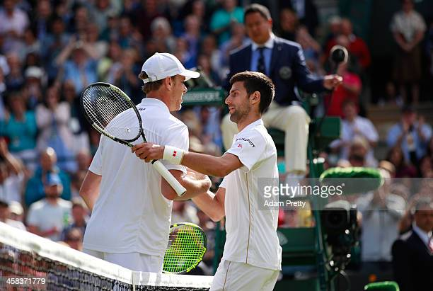 Sam Querrey of The United States shakes hands with Novak Djokovic of Serbia following victory during the Men's Singles third round match on day six...