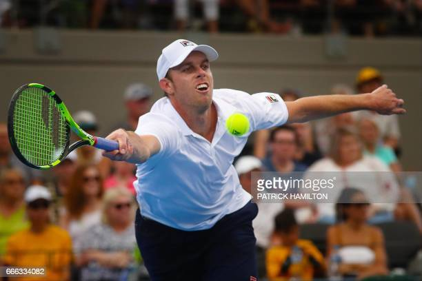 Sam Querrey of the US hits a return to Nick Kyrgios of Australia during their tennis match in the world group quarterfinal Davis Cup clash between...