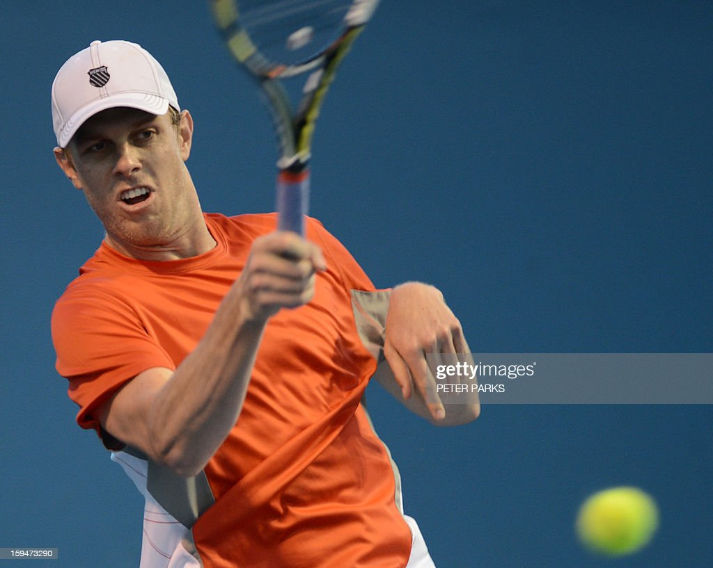 Sam Querrey of the US plays a return during his men's singles match against Spain's Daniel Munoz-de la Nava the first day of the Australian Open tennis tournament in Melbourne on January 14, 2013. AFP PHOTO/PETER PARKS IMAGE STRICTLY RESTRICTED TO EDITORIAL USE - STRICTLY NO COMMERCIAL USE