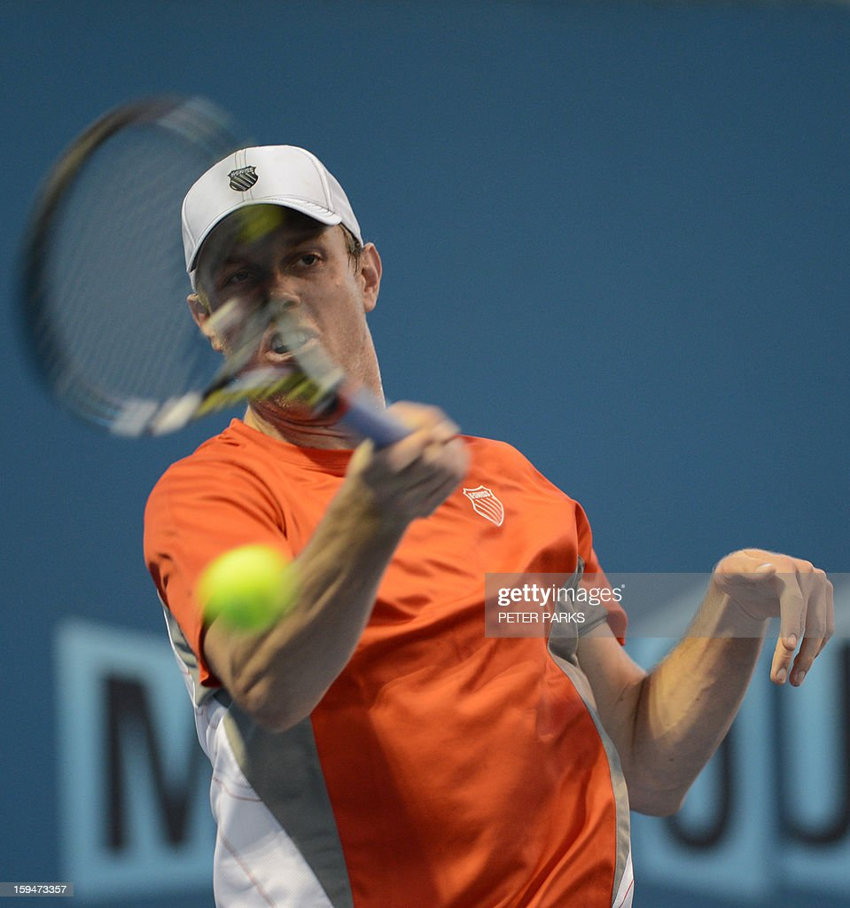 Sam Querrey of the US plays a return during his men's singles match against Spain's Daniel Munoz-de la Nava the first day of the Australian Open tennis tournament in Melbourne on January 14, 2013.