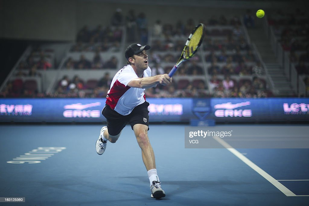 Sam Querrey of the U.S. returns a ball to Novak Djokovic of Serbia during day seven of the 2013 China Open at National Tennis Center on October 4, 2013 in Beijing, China.