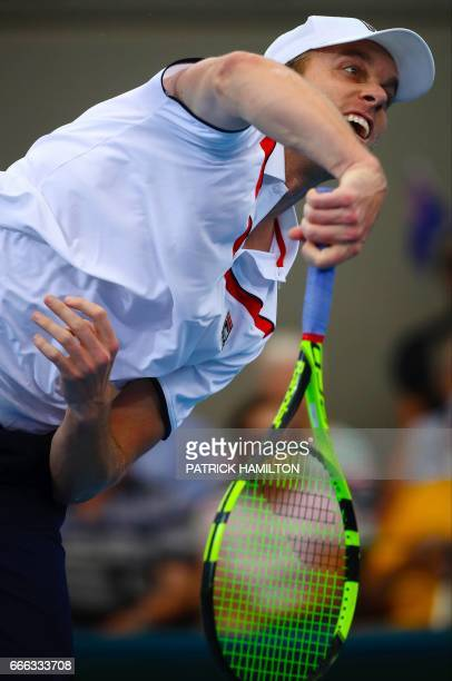 Sam Querrey of the US serves to Nick Kyrgios of Australia during their tennis match in the world group quarterfinal Davis Cup clash between Australia...