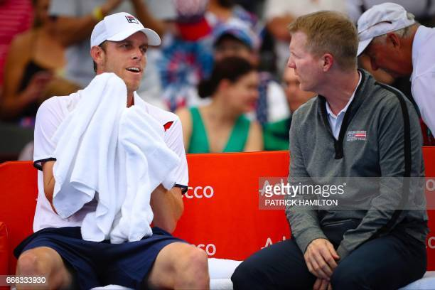 Sam Querrey of the US sits with team captain Jim Courier during his tennis match against Nick Kyrgios of Australia during their tennis match in the...
