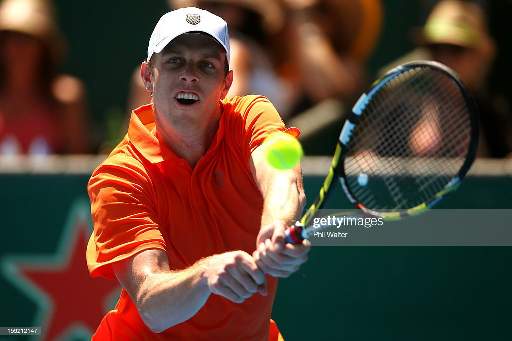 <a gi-track='captionPersonalityLinkClicked' href=/galleries/search?phrase=Sam+Querrey&family=editorial&specificpeople=736491 ng-click='$event.stopPropagation()'>Sam Querrey</a> of the USA plays a backhand in his quarterfinal match against Jesse Levine of Canada during day four of the Heineken Open at the ASB Tennis Centre on January 10, 2013 in Auckland, New Zealand.