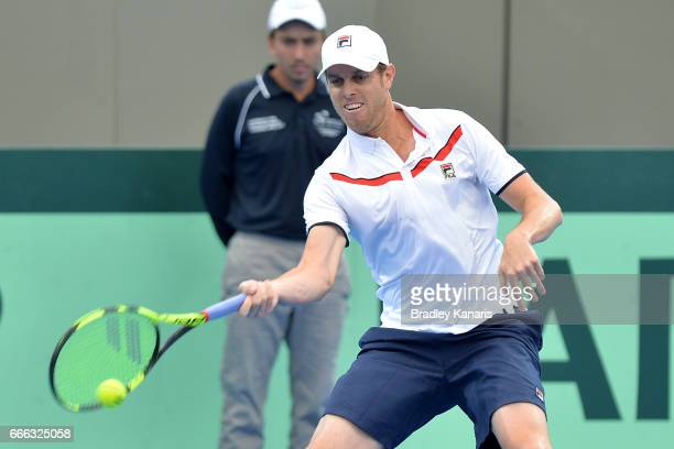 Sam Querrey of the USA plays a forehand in his match against Nick Kyrgios of Australia during the Davis Cup World Group Quarterfinals between...