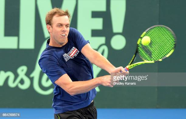 Sam Querrey of the USA plays a shot during a practice session ahead of the Davis Cup World Group Quarterfinals tie between Australia and the United...