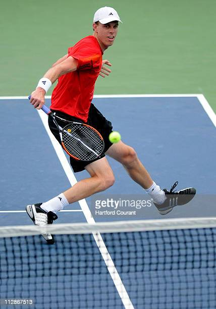 Sam Querrey of the USA slices a backhand return to Bjorn Phau of Germany during the 2009 Pilot Pen Tennis Tournament in New Haven Connecticut...