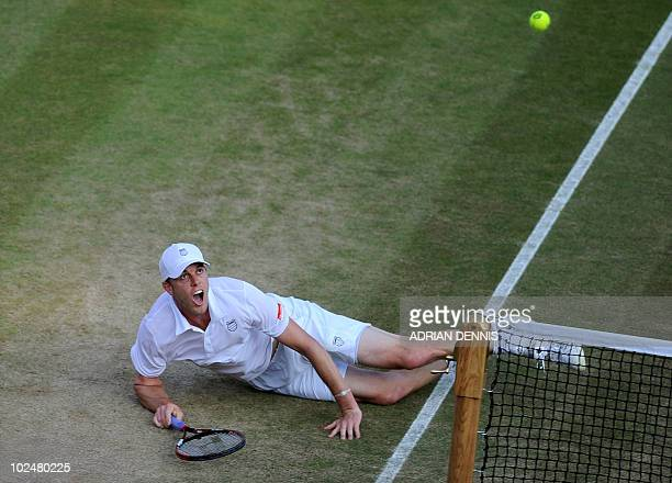 Sam Querrey of US dives for the ball as he plays against Belgium's Xavier Malisse at the 2010 Wimbledon Tennis Championships at the All England...