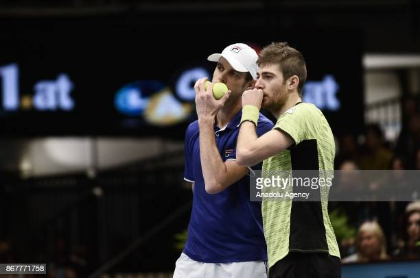 Sam Querrey of USA and Marcelo Demoliner of Brazil in action against Pablo Cuevas of Uruguai and Rohan Boppana of India during Erste Bank Open 500...