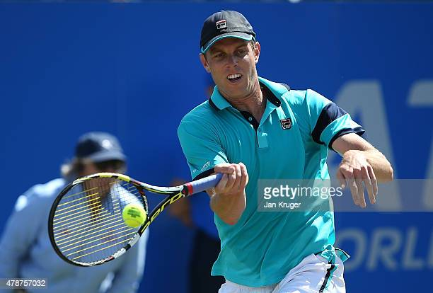 Sam Querrey of USA in action against Denis Istomin of Uzbekistan during the mens singles final match on day seven of the Aegon Open Nottingham at...