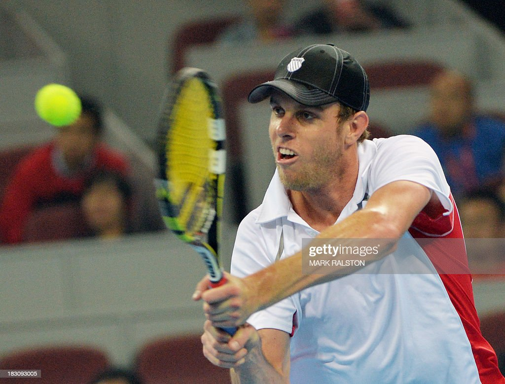 Sam Querrey of USA plays a backhand shot during his men's singles quarterfinals match against Novak Djokovic of Serbia at the China Open tennis tournament in Beijing on October 4, 2013. Djokovic went on to win 6-1, 6-2. AFP PHOTO / Mark RALSTON