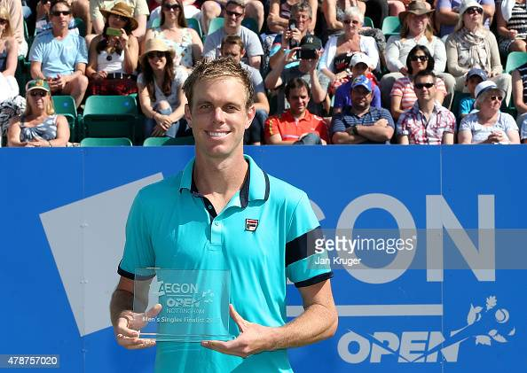Sam Querrey of USA poses with the runners up trophy after loosing to Denis Istomin of Uzbekistan during the mens singles final match on day seven of...