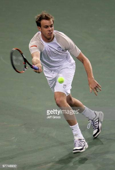 Sam Querrey of USA returns a forehand to John Isner of USA during the BNP Paribas Open at the Indian Wells Tennis Garden on March 15 2010 in Indian...