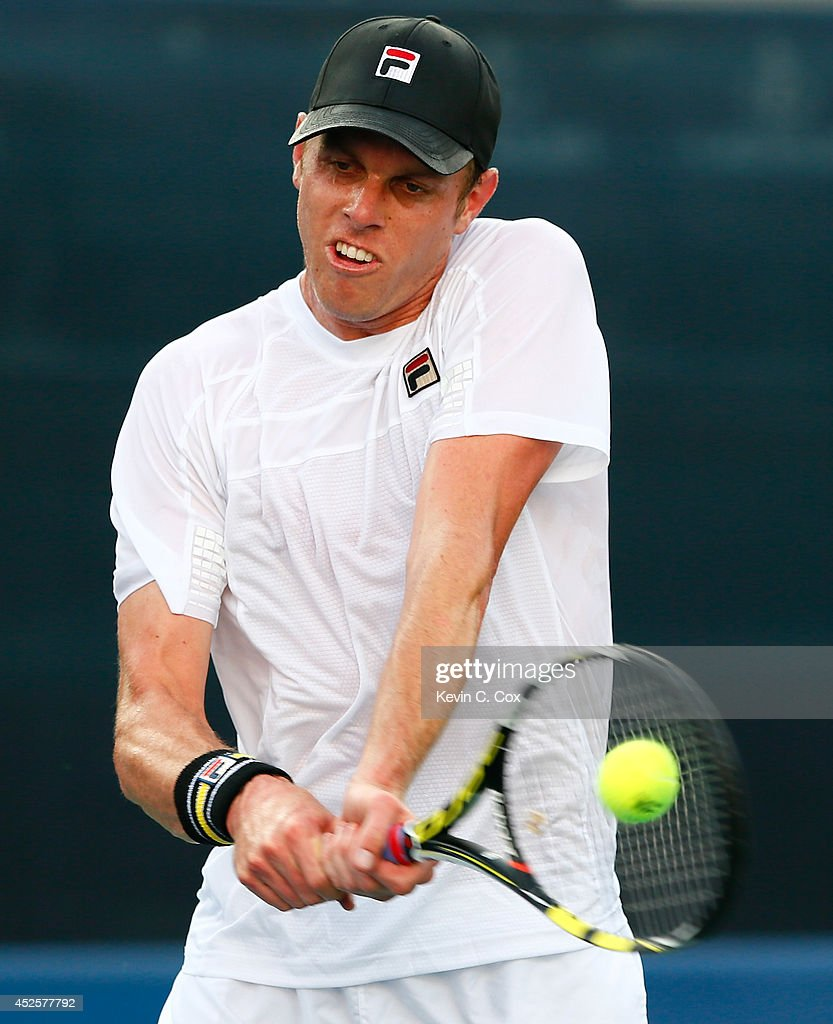 Sam Querrey returns a backhand to Dudi Sela of Israel during the BB&T Atlanta Open at Atlantic Station on July 23, 2014 in Atlanta, Georgia.