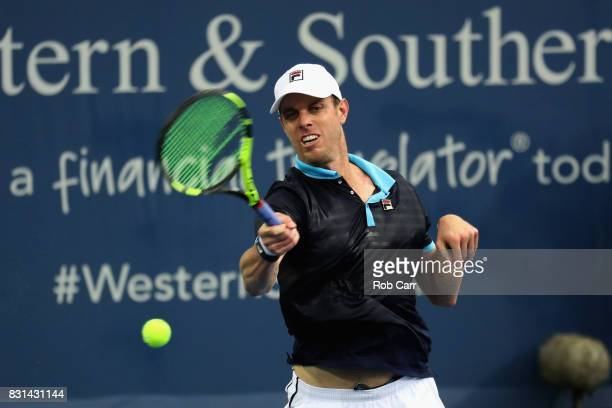 Sam Querrey returns a shot against Stefan Kozlov during the Western and Southern Open on August 14 2017 in Mason Ohio