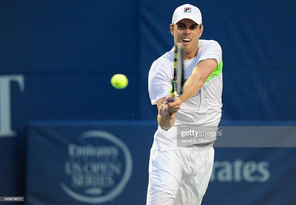 Sam Querrey returns a shot from Kevin Anderson of South Africa during the Winston-Salem Open at Wake Forest University on August 20, 2014 in Winston Salem, North Carolina.