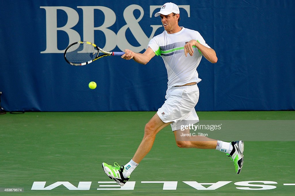 <a gi-track='captionPersonalityLinkClicked' href=/galleries/search?phrase=Sam+Querrey&family=editorial&specificpeople=736491 ng-click='$event.stopPropagation()'>Sam Querrey</a> returns a shot from Kevin Anderson of South Africa during the Winston-Salem Open at Wake Forest University on August 20, 2014 in Winston Salem, North Carolina.