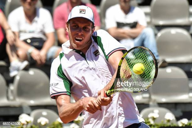 US Sam Querrey returns the ball to France's Lucas Pouille during their ATP Tennis Open tournament match on May 15 2017 at the Foro Italico in Rome /...