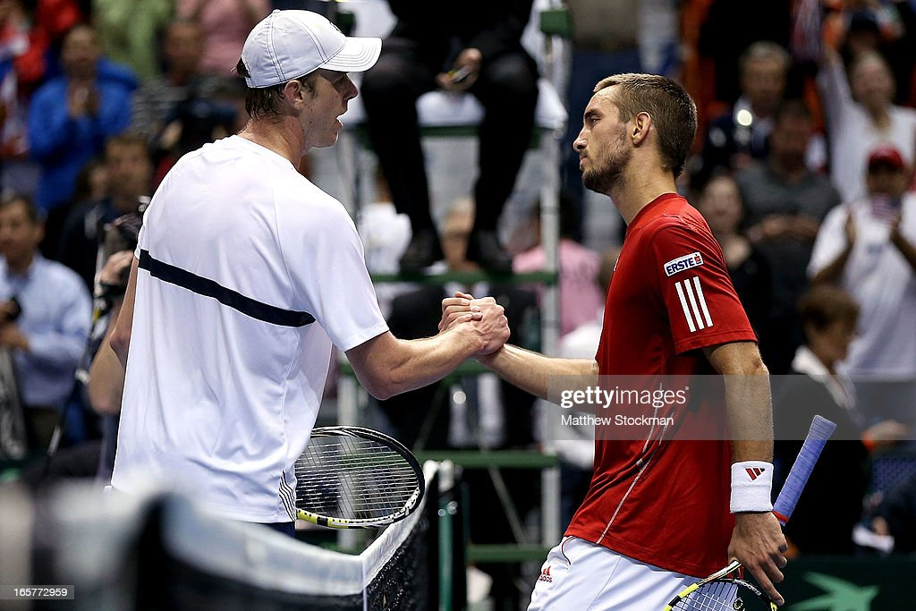 Sam Querrey shakes hands at the net with Viktor Troicki of Serbia after defeating Troicki during the second match of the Davis Cup tie between the United States and Serbia at Taco Bell Arena on April 5, 2013 in Boise, Idaho.