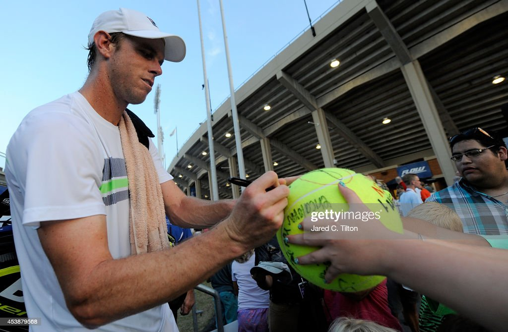 Sam Querrey signs autographs for fans after defeating Kevin Anderson of South Africa during the Winston-Salem Open at Wake Forest University on August 20, 2014 in Winston Salem, North Carolina.