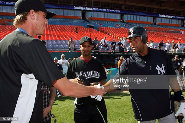 Sam Querrey talks with Derek Jeter of the New York Yankees before a game against the Florida Marlins at Dolphin Stadium on March 29 2008 in Miami...