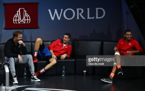 Sam Querrey Thanasi Kokkinakis and Nick Kyrgios of Team World sit on the players bench as Denis Shapovalov of Team World plays his singles match...